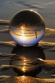 This marble on the beach captures an image that looks like magic!