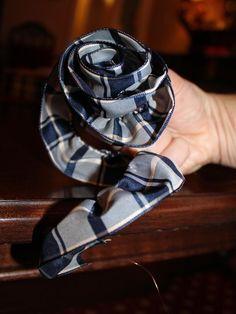 How to Make a Ribbon Rose --> http://blog.hgtv.com/design/2012/12/12/menswear-inspired-gift-wrap-how-to-make-a-ribbon-rose/?soc=pinterest