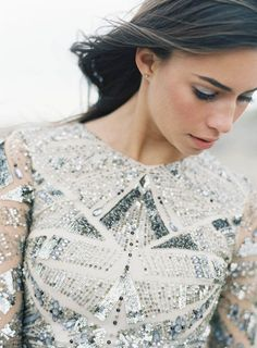 Geometric patterns on a sequin silver and white wedding dress