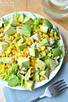 Grilled Corn Salad with Chili Lime Vinaigrette  1 romaine heart, torn 1/2 c. corn kernels (grilled, roasted, or browned in a frying pan) 1/2 avocado, chopped 1/4 c. blue cheese, crumbled Chili Lime Vinaigrette 1/4 c. olive oil 1 Tbsp. golden balsamic vinegar 2 Tbsp. lime juice 1 Tbsp. honey 1 tsp. chili garlic sauce 1/8 tsp. chili powder 1/8 tsp. cumin