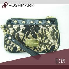 🎉🎉Betsey Johnson Lace Wristlet Purse Betsey Johnson Lace Wristlet Purse.  Product Features Zip Top Closure Gold Hardware Trimmed in Faux Patent Leather With Lacey Fabric Betsey Johnson Signature Gold Logo Plaque On The Front 7″W x 4″H Betsey Johnson Bags Clutches & Wristlets
