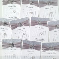 Silver Save the Date Calendar | The Cinderella Collection - Save the Date Calendar | Featuring silver glitter paper, silver grey ribbon and rose embellishment | Luxury handmade wedding invitations and stationery #byenchanting