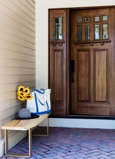 The Boston Design Home at Turner Hill features this formal Pella mahogany Craftsman style entry door. Click for a tour!