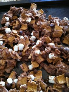 Smores Snack Mix!  1/2 bag Golden Grahams Cereal  1/2 large bag mini marshmallows (divided in half)  1/2 bag (or 6 oz.) chocolate chips (divided in half)  2 T unsalted butter or margarine  Nonstick spray (not olive oil!)