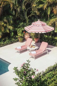 palm beach style poolside with pink umbrella