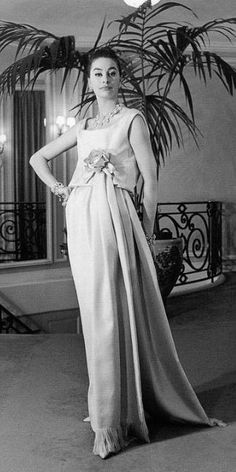 Christine Tidmarsh wearing an evening gown by Yves Saint Laurent for Dior, 1958.