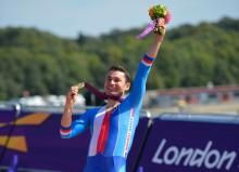 Czech Republic's Jiri Jezek celebrates after winning the gold medal in the men's individual C4 time trial road cycling finals in London Paralympics in 2012 and will be leading off the individual time trail on Stage 11 of the Tour de France