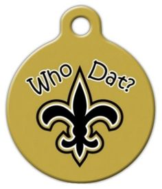 """This tag is perfect for any New Orleans Saints fan. It features the """"Who Dat?"""" fan chant with a fleur de lu symbol on a gold background.Each of our dog ID tags are designed and illustrated by artists from all over the globe, and printed with affection and care in the mountains of North Carolina. They are ultra-durable and are guaranteed to always be legible."""