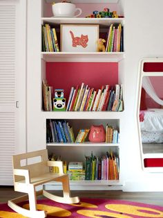 Take advantage of a recessed wall by turning it into a bookshelf. Keeping your little one?s favorite toys and books on the lower shelves means cleanup after playtime is a snap. A splash of hot pink painted behind just one shelf keeps the structure looking fun..