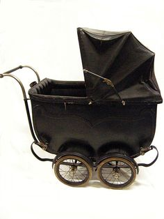 Pram -- The Boston Perambulator made in England, circa 1920-1929.  Materials used -- wood, metal, leathercloth, and rubber compound.
