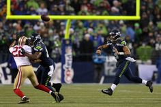 On a rainy night at CenturyLink Field, the Seahawks used a deluge of big plays and time-consuming TD drives to slap the NFC West-leading 49ers with a 42-13 setback to clinch a playoff berth.