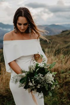 modern and minimal wedding dress with off-shoulder cape detail    #modern #bride #cape #wedding #dress