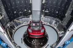 SpaceX CEO Elon Musk's midnight cherry red Tesla Roadster, which will be launched into space on the first Falcon Heavy rocket test flight, is seen before encapsulation inside its protective payload fairing. SpaceX's debut Falcon Heavy rocket will launch i Tesla Motors, Elon Musk Car, Elon Musk Tesla, Tesla Roadster Sport, Roadster Car, Tesla Spacex, Elon Musk Spacex, United Airlines, Mars