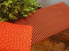 Halloween Table Runner Jack o Lanterns Reversible Orange Black Stripes Padded Halloween Prints, Halloween Sale, Halloween Wine Bottles, Halloween Table Runners, Jack O, Cloth Napkins, Summer Sale, Black Stripes, Printing On Fabric