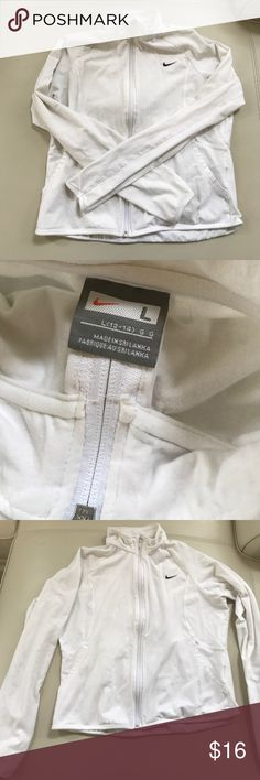 White NIKE zip up thin athletic jacket large Size large but could fit medium too - it is too big for me, I would keep it otherwise!! Has a couple of tiny spots but in good used condition otherwise Nike Tops Sweatshirts & Hoodies