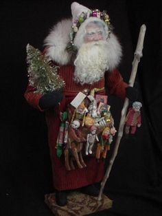 "Another one of Norma's masterpieces!  ""Thanks, but notice the number of toys.  David cleans the shelves on almost every Santa."""