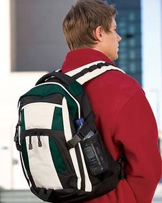 """Port Authority Urban Organizer Pocket Shoulder Strap Backpack. BG77  The latest in style and utility for your urban excursions and thoughtful features make it useful on the trail, too. 600 denier ripstop polyester with contrasting poly for reinforcement, Waist and chest straps for hiking, padded handle and back, Interior padded laptop sleeve, Organizer pocket, MP3 player pocket with headphone exit port, Laptop sleeve dimensions: 11.8""""h x 11.6""""w x 1.8""""d,"""