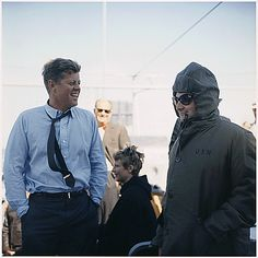 Watching the America's Cup race, Kennedy talks with press secretary Pierre Salinger aboard the USS Joseph P. Kennedy. http://www.rosettabooks.com/?s=JFK