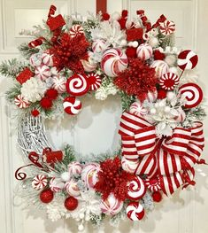 Warm & Festive Red and White Christmas Decor Ideas - Hike n Dip <br> Give your Christmas decoration a festive touch. Try the classic Red and white Christmas decor. Here are Red and White Christmas decor ideas for you. Rustic Christmas, Red Christmas, Christmas Crafts, Candy Cane Christmas Tree, Christmas Time, Christmas Pictures, White Christmas Wreaths, Homemade Christmas Wreaths, Christmas Swags