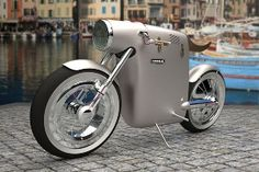 Whoa.  An electric bike, designed by the Spanish firm ART-TIC, inspired by the Ossa monocasco motorcycle of Santiago Herrero, the legendary Grand Prix racer who died racing in 1970