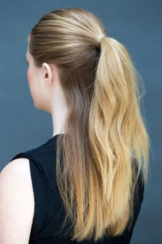"Pull the hair above your ears into a half-up half-down pony, leaving the hair beneath your ears loose. ""Use a boar bristle brush to sweep hair into the top pony to create smooth lines and no bubbles on the sides,"" says Peña."
