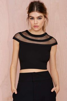 This black crop top is perfect for showing off those toned arms.