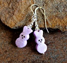Easter bunny earrings, how cute are these! These polymer clay beads were created by the artist of Treasures in Clay. Also included are Swarovski crystals, and sterling silver bead caps, findings and ear wires. These earrings measure a little less than 2 inches.  They are light weight. @--;-----