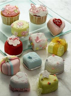 Petit fours are so cute. Mostly from My long held obsession with miniature stuff. I think I'd be afraid to eat it and mess it up. - Source http://pinterest.com/pin/456693218433086579/