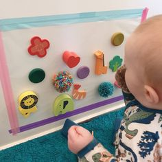 """Another activity that is giving him the chance to practise his sitting and balance. It is also helping his hand eye…"""" Sensory Wall, Sensory Boards, Daycare Rooms, Home Daycare, Infant Art, Infant Room, Sensory Bottles, Preschool Lesson Plans, Baby Learning"""