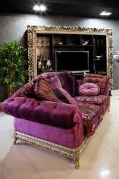 Beautiful purple sofa in a modern apartment And that huge mirror