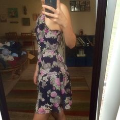 """NWOT Floral halter cut out back dress Super cute and flattering! Really great to dress up for like a wedding or just a nice spring time dress! Adjustable straps that tie in the back to form a cut out """"v"""". Size small/xsmall. I'm 5""""3' if that helps with sizing!  never worn out, NWOT Dresses"""