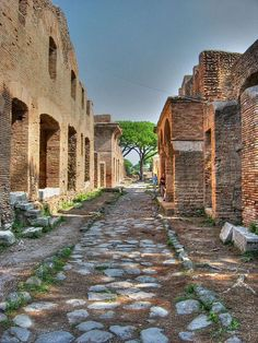 Ostia (now Ostia Antica), the ancient Roman city that was the port of Rome, Italy.  The city is largely preserved and excavated and is one of the best preserved Roman cities in Italy.  Pictured is Via della Casa di Diana - two-story apartment buildings.  by iessi
