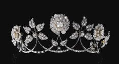 DIAMOND FOLIATE & FLORAL TIARA, LATE 19TH CENTURY. Designed as a graduated series of swags each surmounted alternatively with floral and foliate motifs. Each floral and foliate motif detachable, accompanied by five brooch fittings. (Sotheby's)