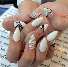 White designs stilletto nails