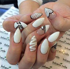 White designs stilletto nails