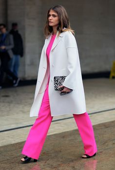 Street style: Neon pink at NYFW Fall 2012  Let's start with the always stunning, beautiful, Elisa Sednaoui in a neon pink jumpsuit and white coat.