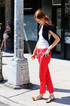 Orange pants and white tank ~ The Best Street Style From New York Fashion Week  - ELLE.com