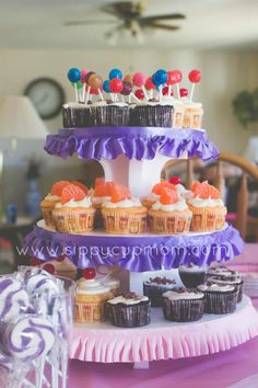 Cupcake Birthday Party. Using a plain white cupcake stand, add your own ribbon trim to create the perfect cupcake display for your party.