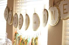 Layered gold and white doilies make a beautiful name banner #birthday