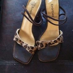 BEBE LEOPARD STRAPPY SHOES!! Great looking BEBE leopard strappy shoe. Been worn a half of dozen times. Still in great condition and very nice looking. bebe Shoes