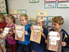 First graders proudly displaying Leonardo da Vinci portraits.