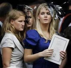 Lady Kitty Spencer on the right, with her cousin Celia McCorquodale giving her a strange look on the left, and one of Kitty's sisters in the middle - at the memorial service for their aunt Princess Diana.