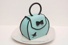 How to make a purse cake.  This lady has some great how to's on this blog for cake decorating!