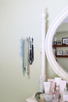 Command™ Spring Clips work great to hang up jewelry in a bedroom.