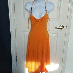 flowy dress very nice detail on the dress in very good condition will fit small to medium.very stretchy material..like new.also do trade Dresses Midi