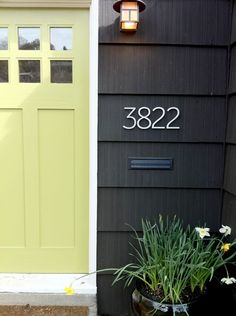 Love the front door - style and color - the house numbers, light fixture and the dark gray siding.