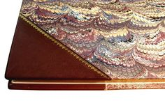 Half leather binding with corners.Calf leather from Hewitt. Handmade marbled paper. Gilding with genuine gold.