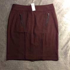 Woman's a line skirt Woman's a line skirt with zippered packets really classy dark burgundy color Ann Taylor Skirts A-Line or Full