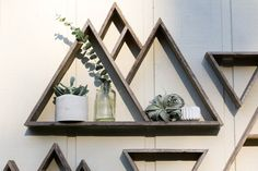 This is a Beautiful Mountain Range Triangle Shelf handcrafted from Reclaimed Pallet Wood. This shelf is totally unique and one of a kind as it is made from recycled wooden pallets that we salvage from local small businesses. I have one hanging in my room and absolutely love it! The possibilities are endless as this shelf works well alone or in a grouping. With multiple triangle shelves of various sizes you can create amazing, functional wall art. The dimensions of this piece are…