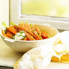 Sweet Curry Carrots with Chive Yogurt Roasting brings out the natural sweetness of the carrots, which is enhanced by the honey and curry.